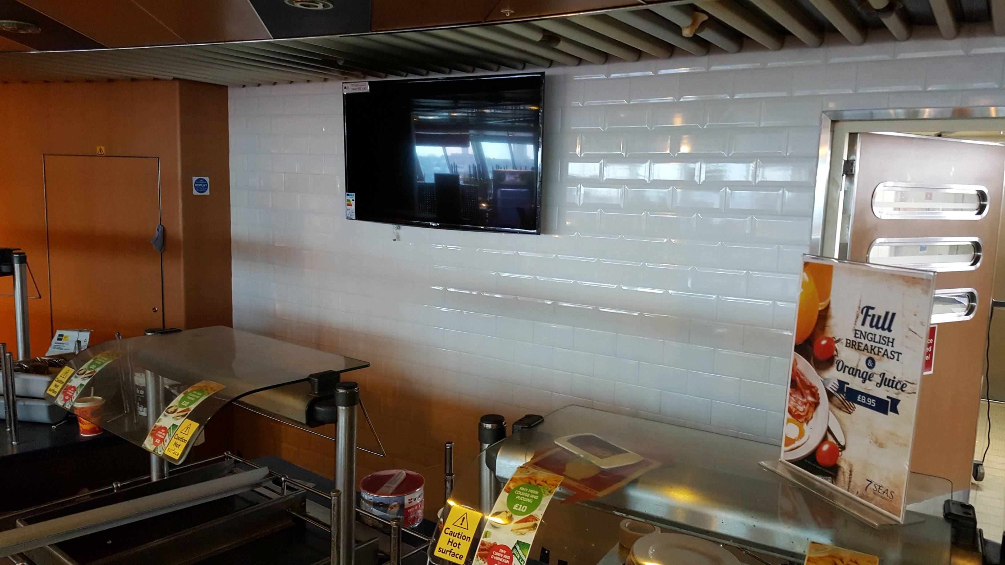 New tiling behind servery